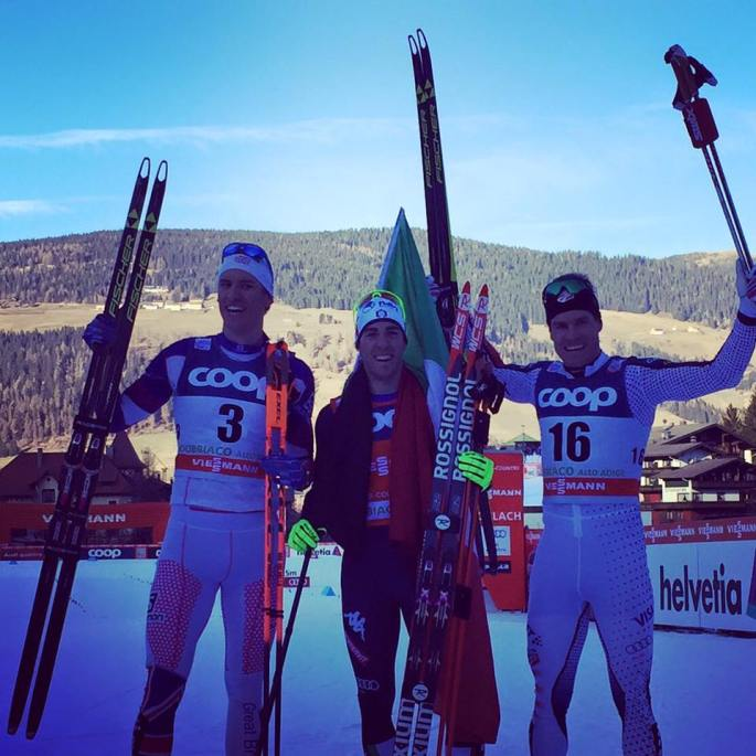 Men's sprint podium: Andrew Young (3rd), Frederico Pellegrino (1st), Simi Hamilton (2nd). (photo by FIS skiing)